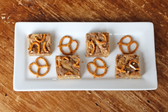 Salted Caramel Blondies are made with caramel sauce and crushed pretzels to provide a delightfully sweet and salty dessert!   Recipe by @haleydwilliams