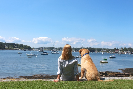 Girl and her dog at a harbor in Maine